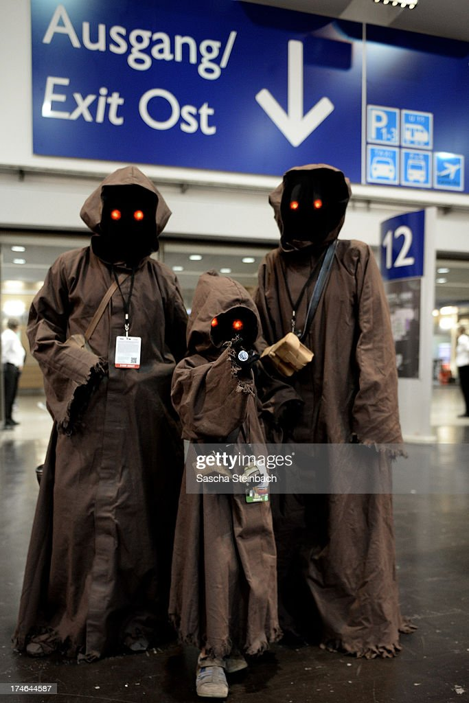Fans from all over the world pose wearing dressed as Star Wars characters during the Star Wars Celebration at Messe Essen on July 28, 2013 in Essen, Germany.