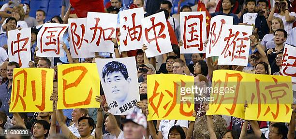 Fans from China hold signs in support of Yao Ming the NBA number one draft pick for 2002 before the start of his game against the USA 31 August 2002...