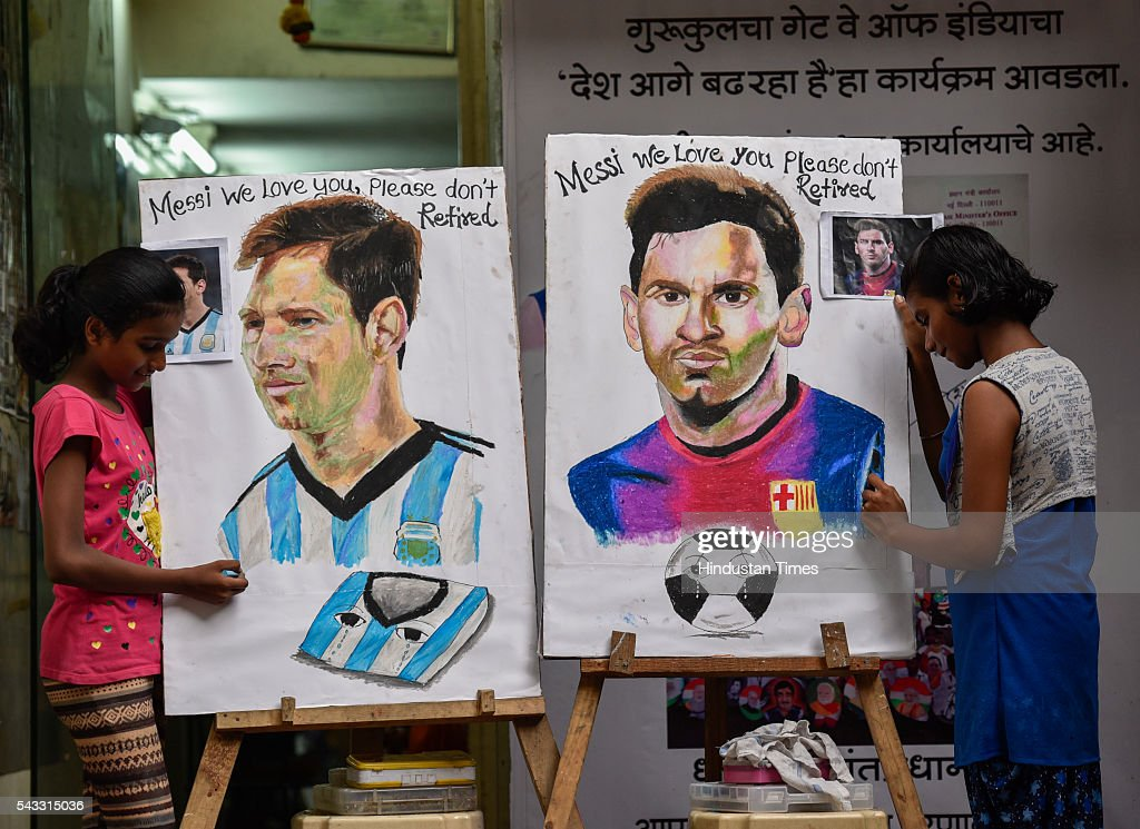Fans from Gurukul school, Lalbaug request Argentine footballer Lionel Messi not to retire with paintings during a competition on June 27, 2016 in Mumbai, India.