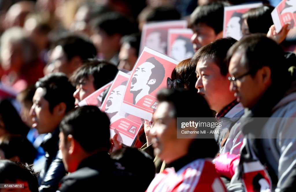 Fans from Japan hold up pictures of Maya Yoshida of Southampton during the Premier League match between Southampton and Hull City at St Mary's Stadium on April 29, 2017 in Southampton, England.