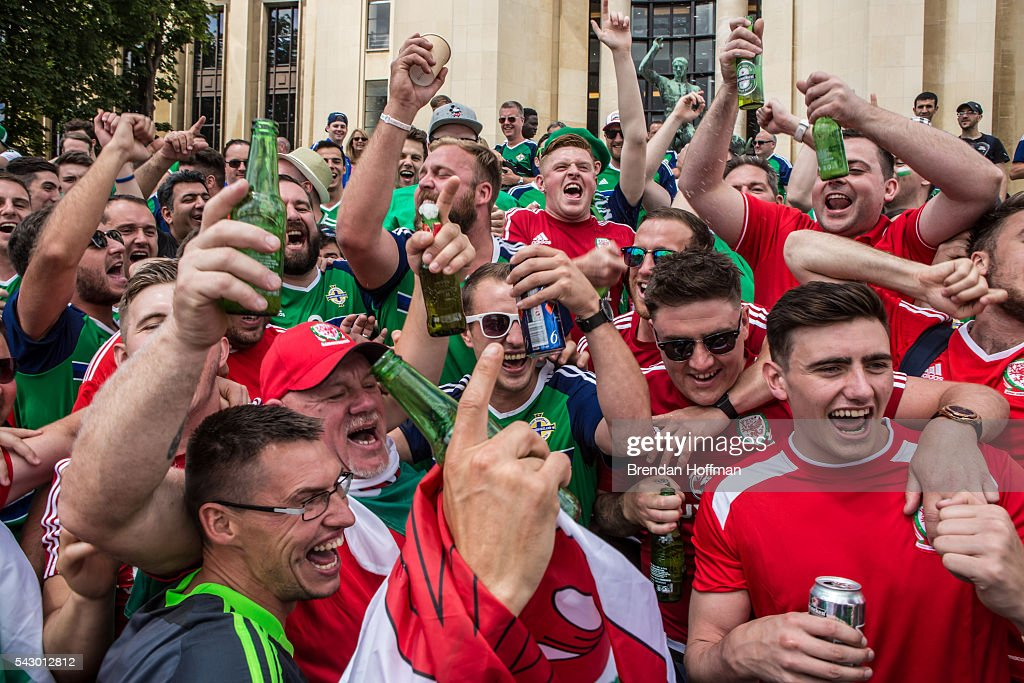 Fans from Wales and Northern Ireland celebrate ahead of the football match between Wales and Northern Ireland during UEFA Euro 2016 tournament on June 25, 2016 in Paris, France. Wales edged Northern Ireland in the Round of 16 at Parc des Princes in Paris.