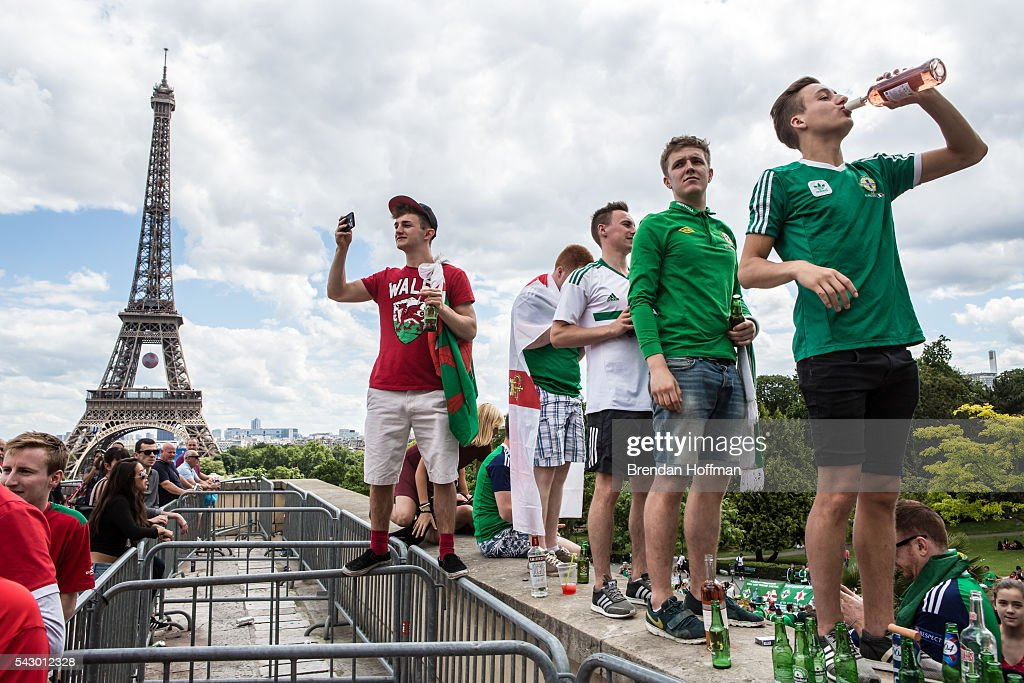 Fans from Wales and Northern Ireland gather to drink and rally near the Eiffel Tower before the football match between Wales and Northern Ireland during UEFA Euro 2016 tournament on June 25, 2016 in Paris, France. Wales edged Northern Ireland in the Round of 16 at Parc des Princes in Paris.