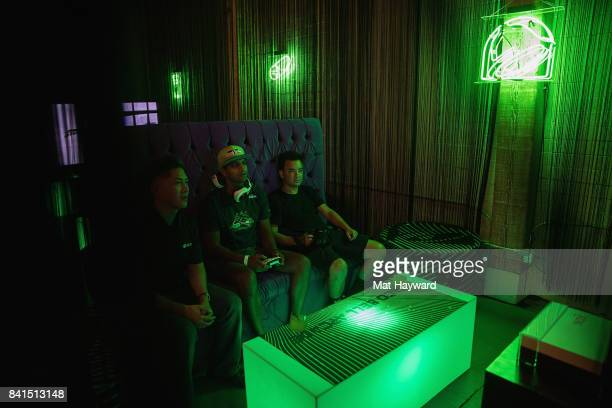 Fans game on the new Xbox One X at the Taco Bell Arcade on August 31 2017 in Seattle Washington