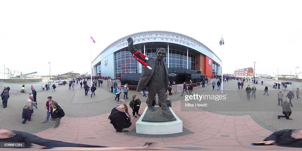 Fans gather around the Ted Bates statue outside the stadium prior to the Barclays Premier League match between Southampton and Manchester City at St Mary's Stadium on May 1, 2016 in Southampton, England.