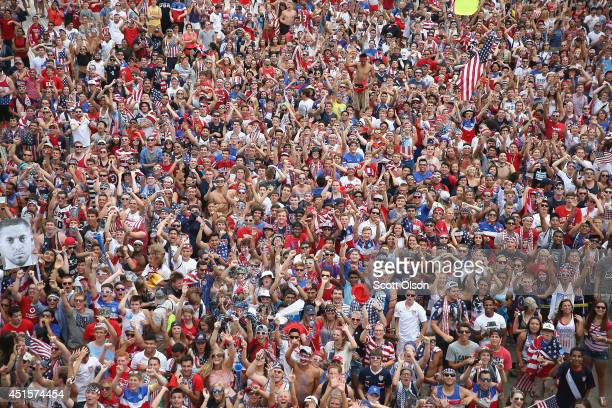 Fans gather at Soldier Field to watch USA take on Belgium in a World Cup match being played at Arena Fonte Nova in Salvador Brazil on July 1 2014 in...