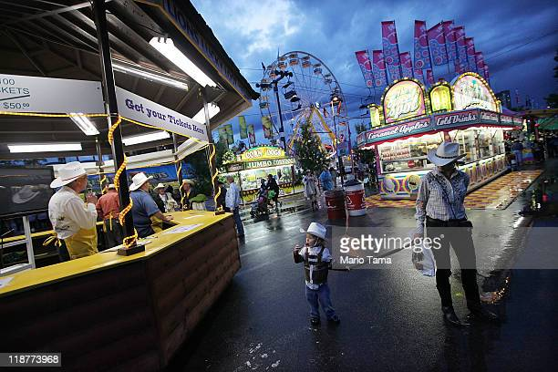 Fans gather at the Calgary Stampede on July 10 2011 in Calgary Canada The tenday event featuring over one million visitors is Canada's largest annual...