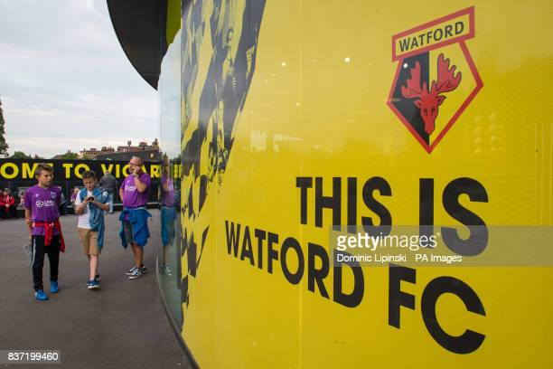 Fans gather before kick off in the the Carabao Cup Second Round match at Vicarage Road Watford