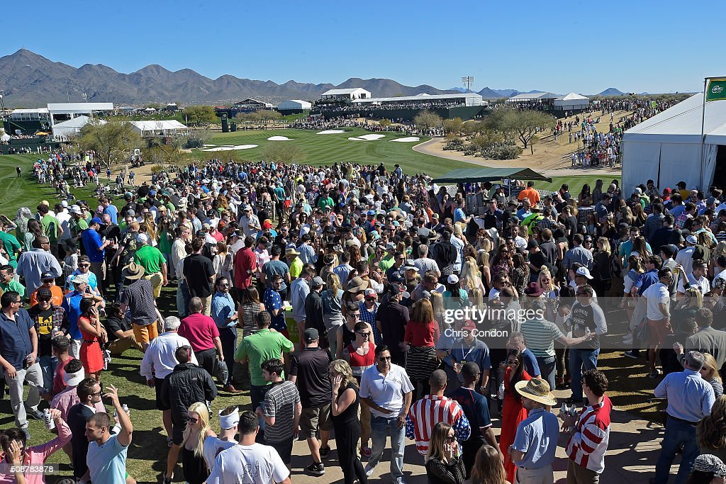 Fans gather behind the 16th hole during the third round of the Waste Management Phoenix Open, at TPC Scottsdale on February 6, 2016 in Scottsdale, Arizona.