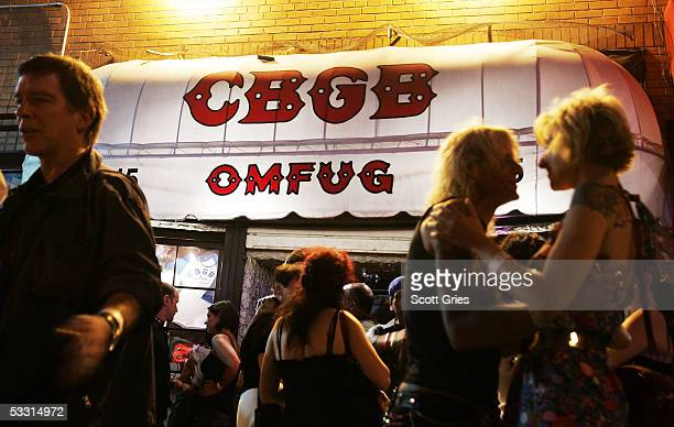 Fans gather outside following a press conference to announce an effort to save legendary punk club CBGB's on the first day of the last month of...