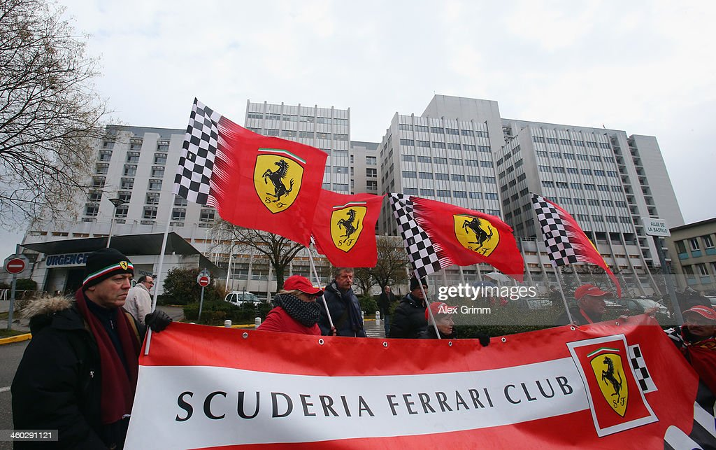 Fans gather outside the Grenoble University Hospital Centre to mark the 45th birthday of former German Formula One driver Michael Schumacher who is being treated for a severe head injury following a skiing accident on Sunday in Meribel on January 3, 2014 in Grenoble, France.
