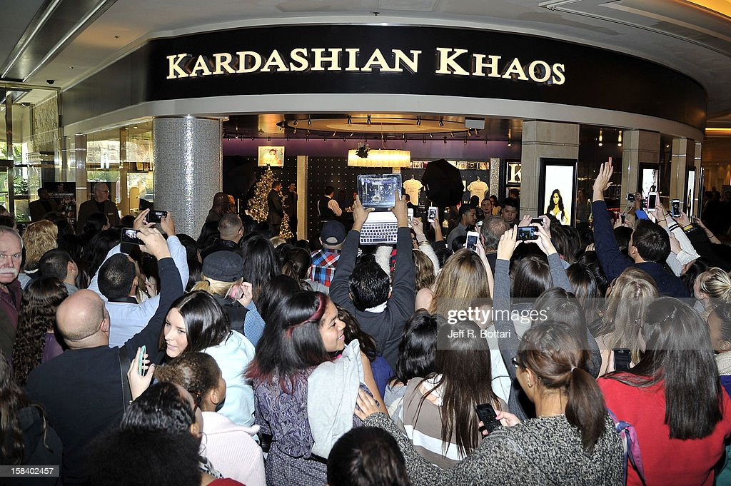 Fans gather to catch a glimpse of television personalities Kendall Jenner and Kylie Jenner at their appearance at the Kardashian Khaos store at The Mirage Hotel & Casino for a fan meet-n-greet on December 15, 2012 in Las Vegas, Nevada.