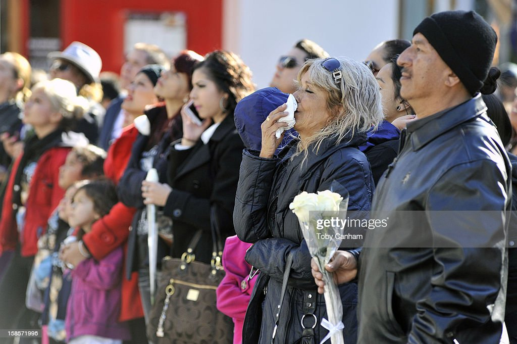 Fans gather to mourn the loss of singer Jenni Rivera at her memorial ceremony held at Gibson Amphitheatre on December 19, 2012 in Universal City, California.