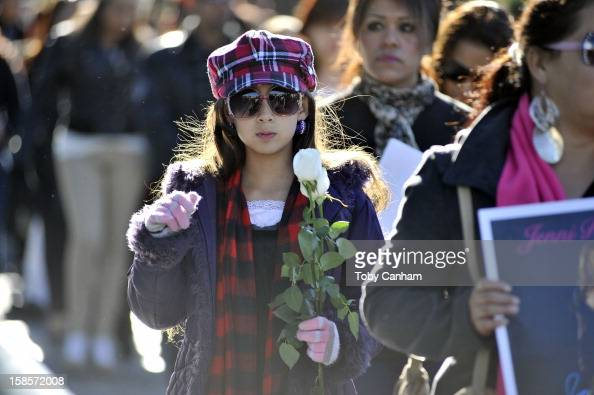 Fans gather to mourn the loss of singer Jenni Rivera at her memorial ceremony at Gibson Amphitheatre on December 19 2012 in Universal City California