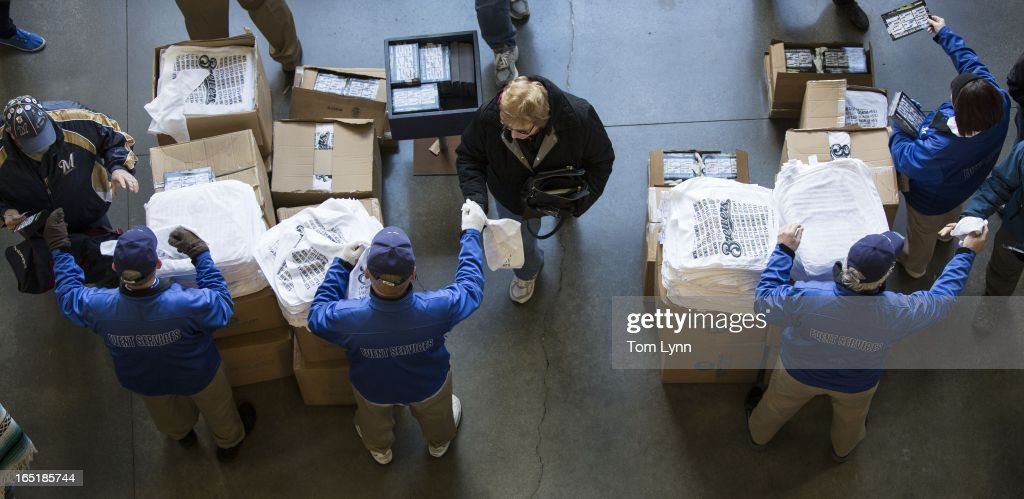 Fans get a rally towel as they enter the stadium for the game between the Milwaukee Brewers and Colorado Rockies on opening day at Miller Park on April 1, 2013 in Milwaukee, Wisconsin.