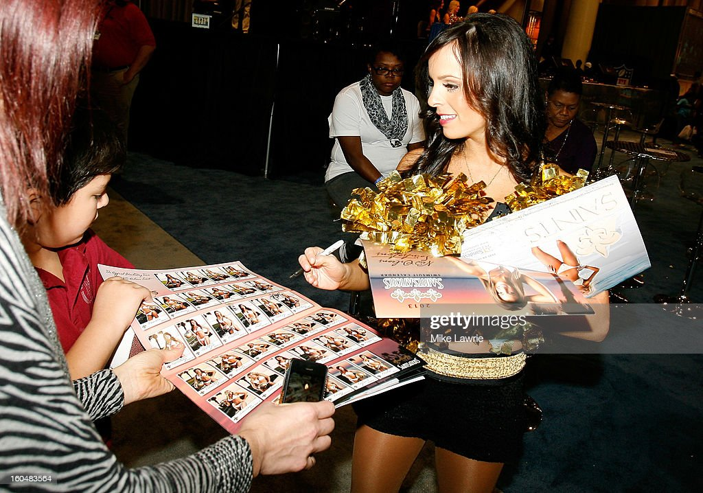 Fans get an autograph from a New Orleans Saints cheerleader during the Super Bowl XLVII NFL Experience at the Ernest N. Morial Convention Center on January 31, 2013 in New Orleans, Louisiana.