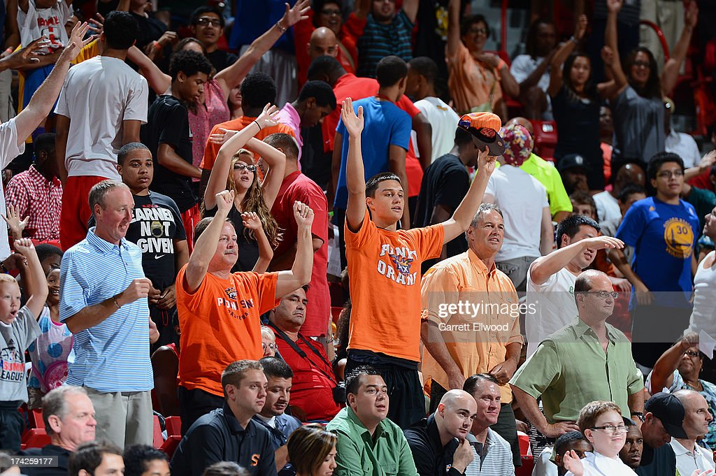 Fans get excited during The Phoenix Suns against the Golden State Warriors during NBA Summer League on July 22, 2013 at the Cox Pavilion in Las Vegas, Nevada.