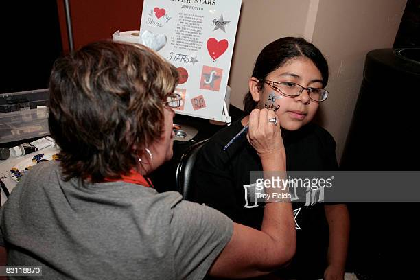Fans gets their face painted prior to Game Two of the WNBA Finals between the Detroit Shock and San Antonio Silver Stars on October 3 2008 at ATT...