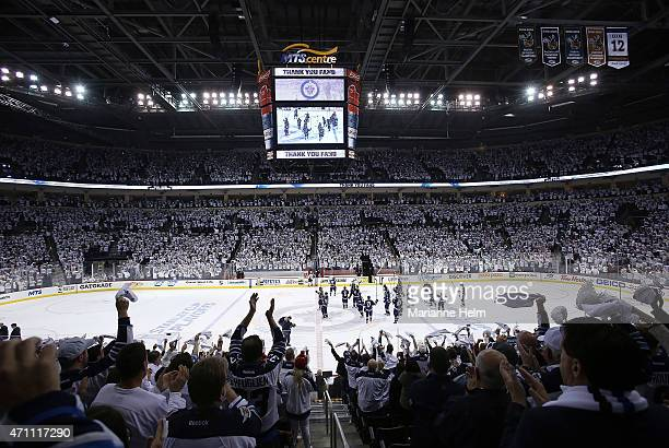 Fans give the Winnipeg Jets a standing ovation as they salute the crowd after they lost to the Anaheim Ducks 52 in Game Four of the Western...
