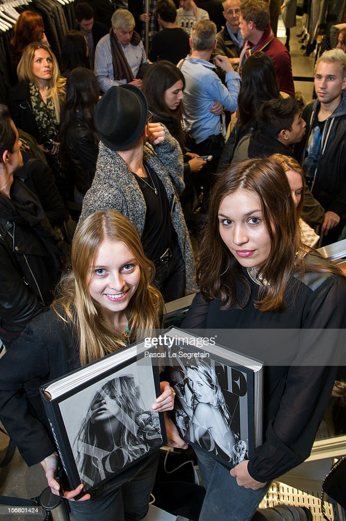 Fans, Gonse Vincent (R) queue to attend the Kate Moss signing session for the book 'Kate: The Kate Moss Book' at Coletteon November 21, 2012 in Paris, France.