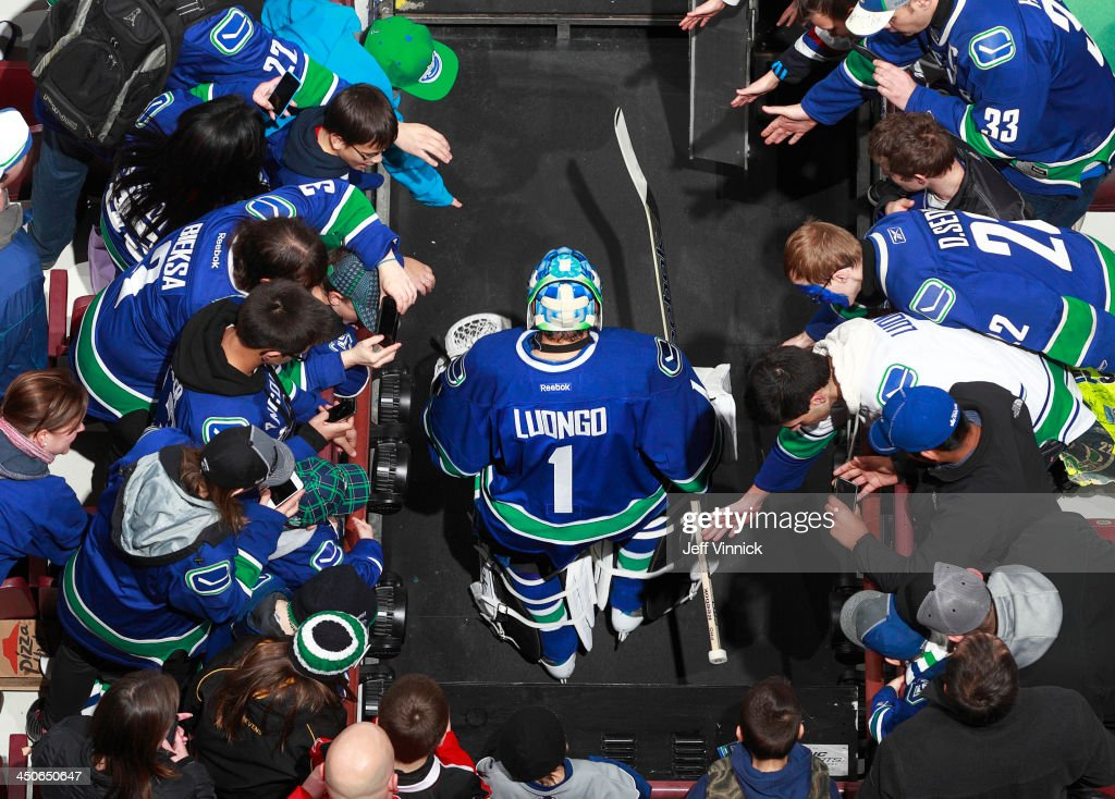Fans greet goaltender Roberto Luongo #1 of the Vancouver Canucks as he warms up for the NHL game against the Florida Panthers at Rogers Arena on November 19, 2013 in Vancouver, British Columbia, Canada.