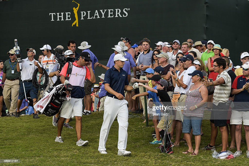 Fans greet Jordan Spieth as he walks to the 18th hole tee box during the third round of THE PLAYERS Championship on THE PLAYERS Stadium Course at TPC Sawgrass on May 10, 2014 in Ponte Vedra Beach, Florida.
