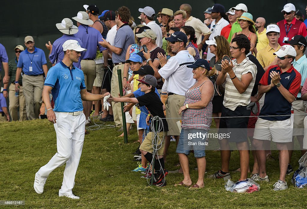 Fans greet Martin Kaymer of Germany as he walks to the 18th hole tee box during the third round of THE PLAYERS Championship on THE PLAYERS Stadium Course at TPC Sawgrass on May 10, 2014 in Ponte Vedra Beach, Florida.