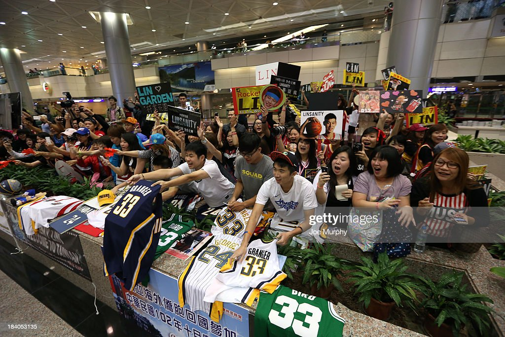 Fans greet the Indiana Pacers as they arrive at the airport during the 2013 Global Games on October 11, 2013 at the Taiwan International Airport.