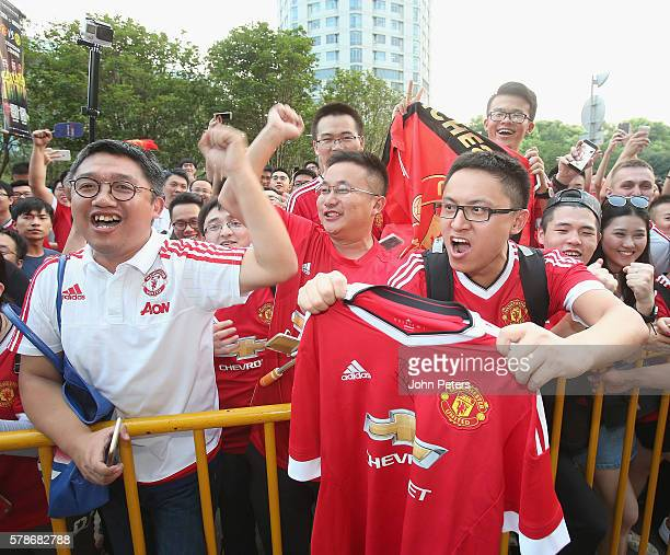 Fans greet the Manchester United team at the stadium ahead of the preseason friendly match between Manchester United and Borussia Dortmund at...