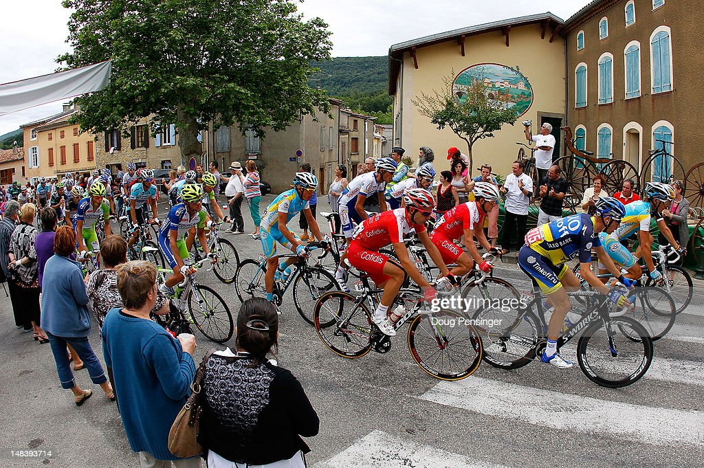 Fans greet the peloton during stage fourteen of the 2012 Tour de France from Limoux to Foix on July 15, 2012 in La Bastide Sur-L'Hers, France.