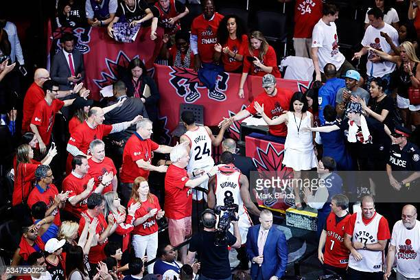 Fans greet the Toronto Raptors as they leave the court after their 87 to 113 loss to the Cleveland Cavaliers in game six of the Eastern Conference...
