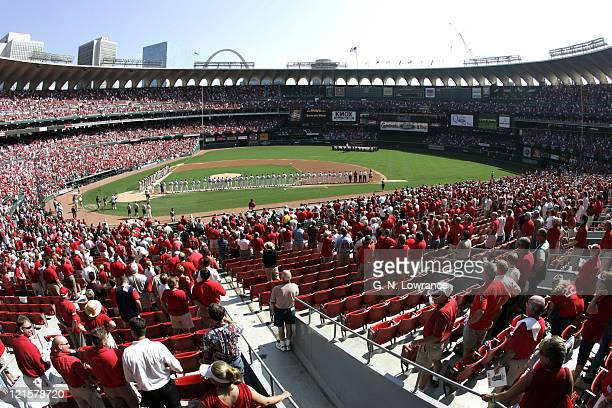Fans greets members of the St Louis Cardinals and San Diego Padres during introductions prior to Game 1 of the National League Divisional Playoffs...