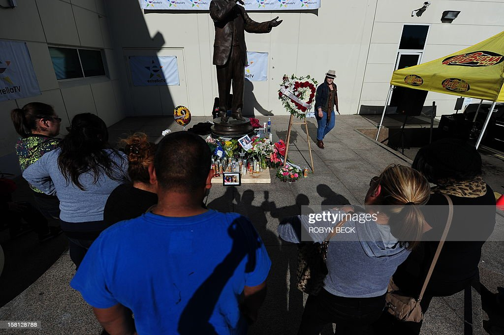 Fans grieve at a memorial of flowers, candles, ballons and notes to the late Mexican-American singing superstar Jenni Rivera, December 10, 2012 in Burbank, California. Rescue workers searched Monday the wreckage of a plane that carried Rivera, a star on both sides of the border, whose death shocked Latin music fans and celebrities.