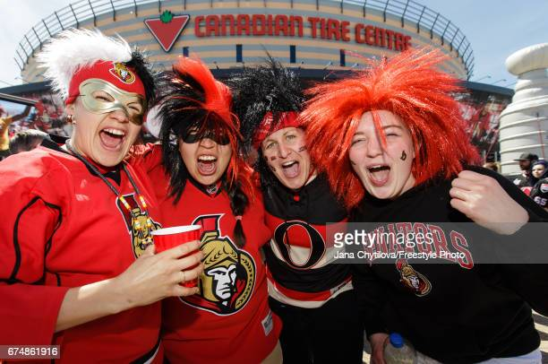 Fans ham it up prior to the start of the game between the Ottawa Senators and the New York Rangers in Game Two of the Eastern Conference Second Round...