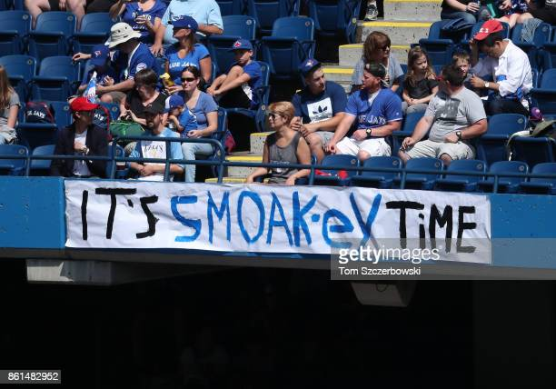 Fans hang a sign in support of Justin Smoak of the Toronto Blue Jays during MLB game action against the Minnesota Twins at Rogers Centre on August 27...