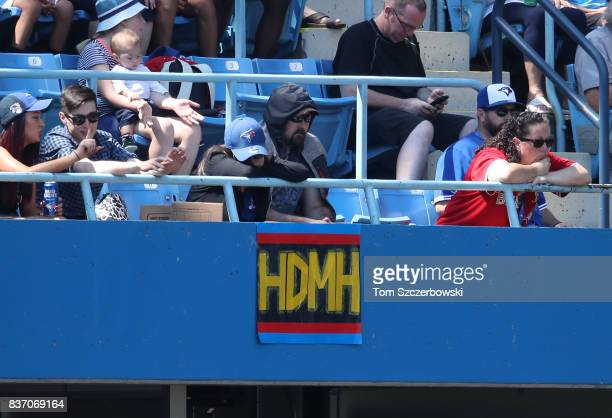 Fans hang a sign of the motto Height Doesn't Measure Heart used to mark a rallying cry by Marcus Stroman of the Toronto Blue Jays on the facing of...