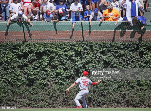 Fans harass Stephen Piscotty of the St Louis Cardinals as he misplays the ball on a double by Jason Heyward of the Chicago Cubs in the 6th inning at...