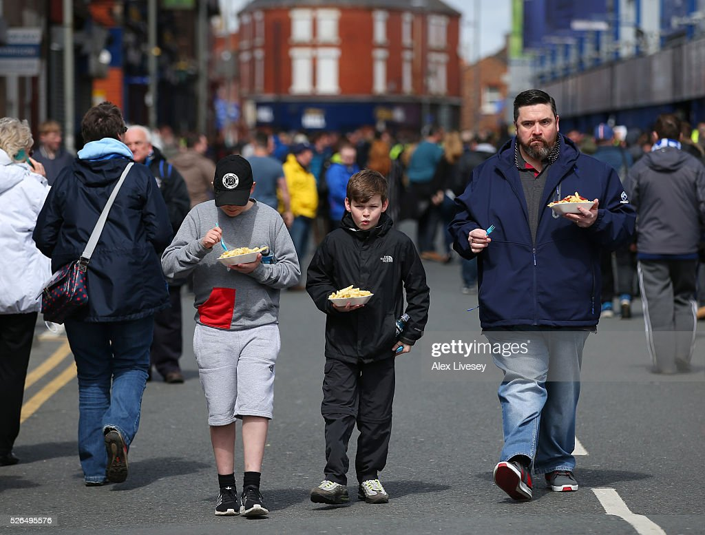 Fans have meals outside the stadium prior to the Barclays Premier League match between Everton and A.F.C. Bournemouth at Goodison Park on April 30, 2016 in Liverpool, England.