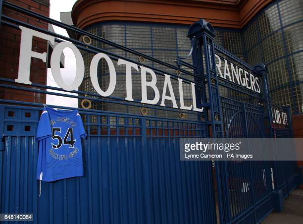 Fans have placed a strip with the number of titles won and a quote from manager Ally McCoist on the gates at Ibrox Glasgow