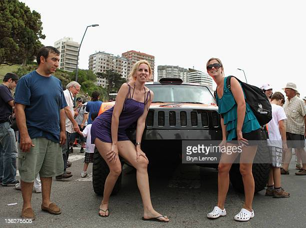 Fans have their photos taken in front of the Hummer to be driven by Robbie Gordon of the USA in the 2012 Dakar Rally on December 30 2011 in Mar del...