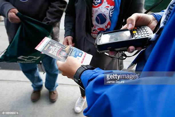 Fans have their tickets scanned before Game Three of the 2016 World Series between the Chicago Cubs and the Cleveland Indians at Wrigley Field on...