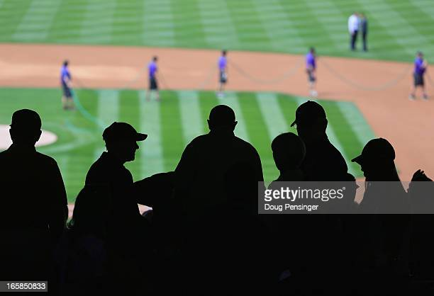 Fans head for their seats as the grounds crew puts the final touches on the field as the San Diego Padres face the Colorado Rockies during Opening...
