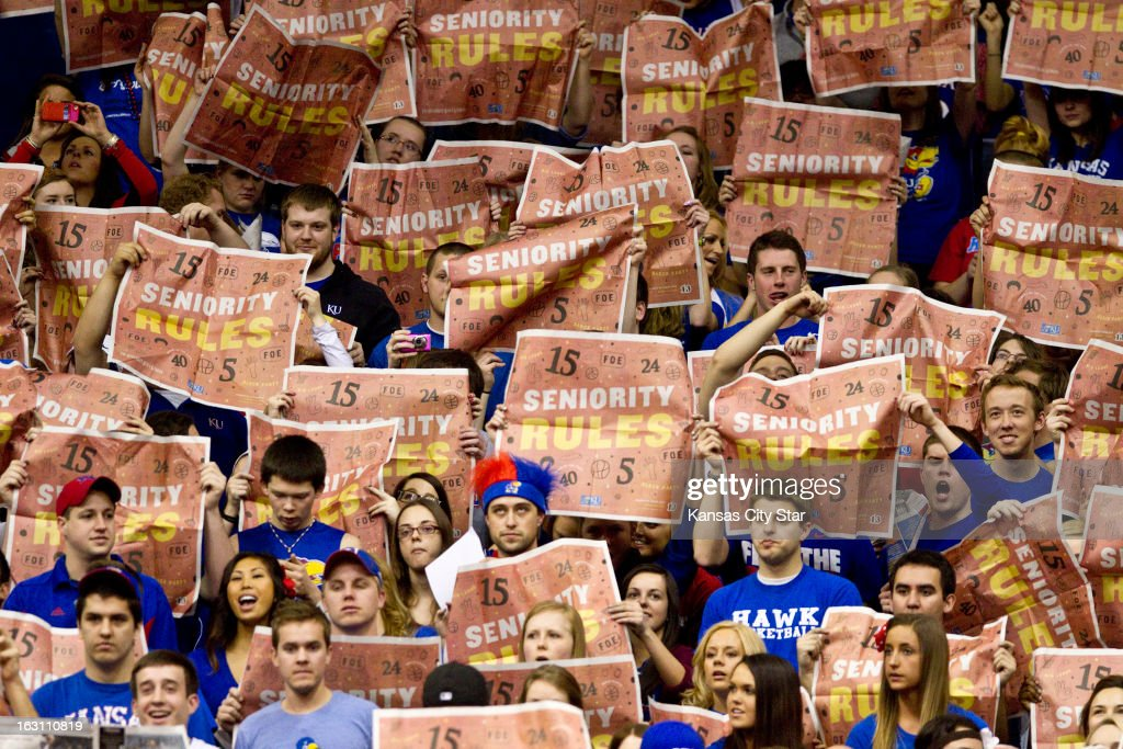 Fans held up newspapers with the words 'Seniority Rules' as Kansas defeated Texas Tech 79-42 on senior night at Allen Fieldhouse in Lawrence, Kansas, Monday, March 4, 2013.