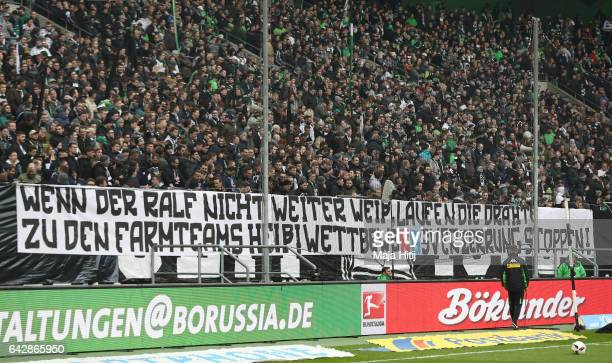 Fans hold a banner during the Bundesliga match between Borussia Moenchengladbach and RB Leipzig at BorussiaPark on February 19 2017 in...