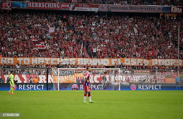 Fans hold a banner reading 'No to matches behind closed doors' during the UEFA Champions League semi final second leg match between FC Bayern...