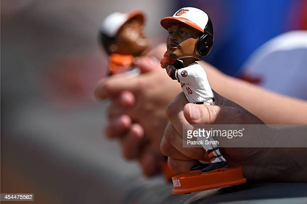 Fans hold a bobble head of Adam Jones of the Baltimore Orioles before the Baltimore Orioles play the Minnesota Twins at Oriole Park at Camden Yards...