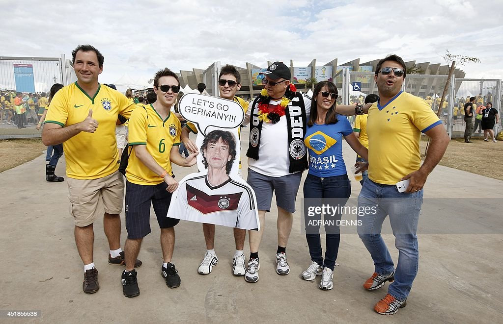 Fans hold a picture of The Rolling Stones' Mick Jagger as they wait outside the Mineirao Stadium in Belo Horizonte before the semi-final football match between Brazil and Germany during the 2014 FIFA World Cup on July 8, 2014.