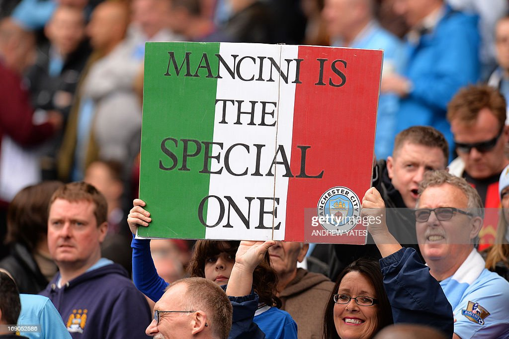 "Fans hold a placard in support of sacked Manchester City manager Roberto Mancini during the English Premier League football match between Manchester City and Norwich City at the Etihad Stadium in Manchester, northwest England, on May 19, 2013. AFP PHOTO / ANDREW YATES USE. No use with unauthorized audio, video, data, fixture lists, club/league logos or ""live"" services. Online in-match use limited to 45 images, no video emulation. No use in betting, games or single club/league/player publications."