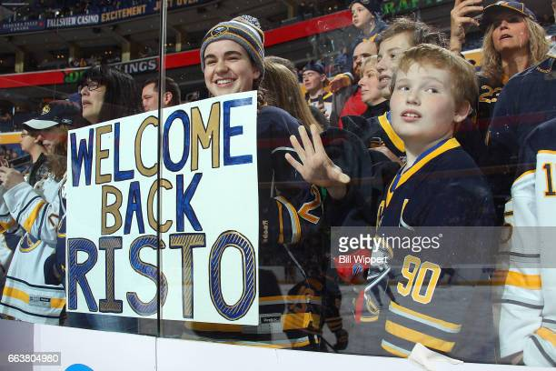Fans hold a sign for Rasmus Ristolainen of the Buffalo Sabres before an NHL game against the New York Islanders at the KeyBank Center on April 2 2017...