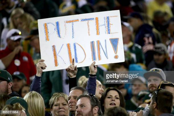 Fans hold a sign referencing Mitchell Trubisky of the Chicago Bears during the game against the Green Bay Packers at Lambeau Field on September 28...