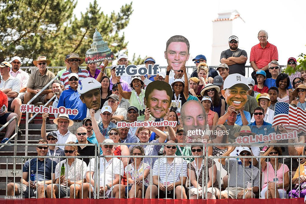 Fans hold Fatheads of players on the first hole tee box during the final round of the Quicken Loans National at Congressional Country Club (Blue) on June 26, 2016 in Bethesda, Maryland.